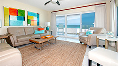 Beach colors in the living room of Surfside 301 a 3 bedroom 2 bath beachfront condo